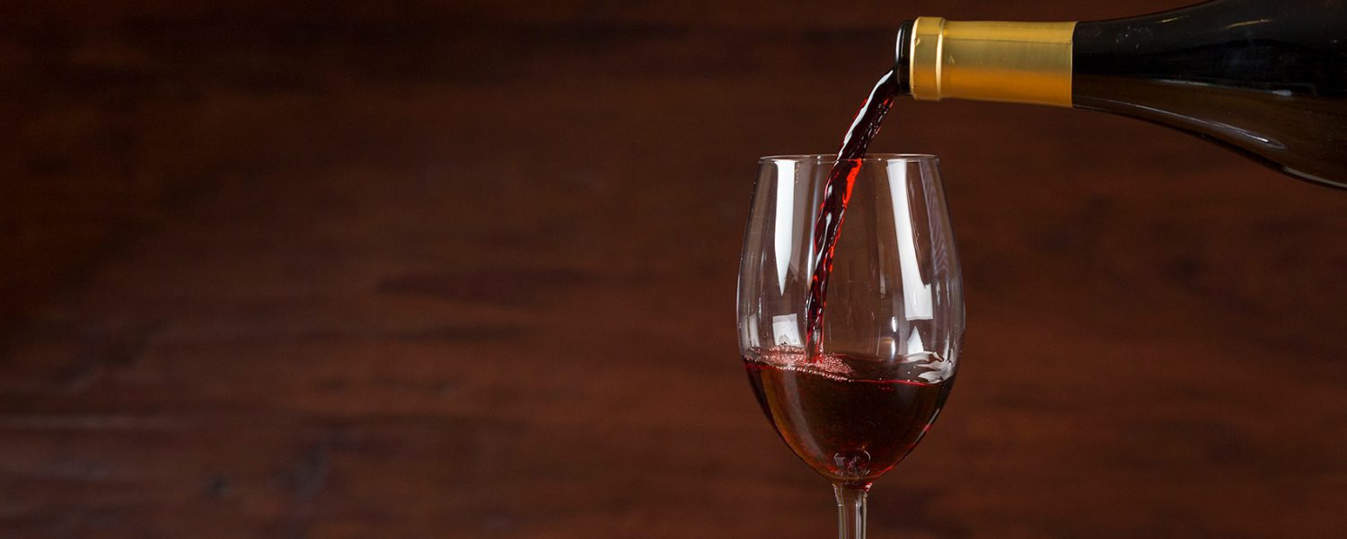 Red wine pouring close up