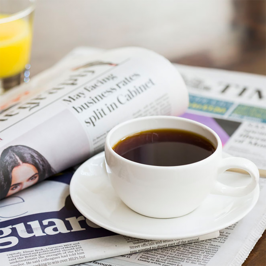 morning cup of coffee with newspaper
