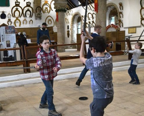 Children practising Sword Skills at Oakham Castle